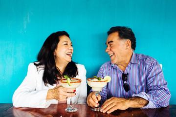 Couple laughing while celebrating