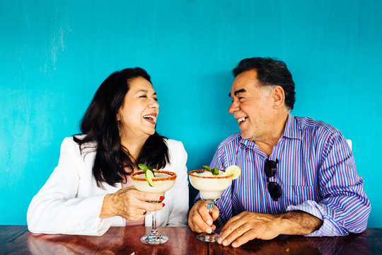 Couple laughing while celebrating
