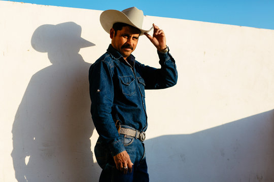 Man with hat posing for camera, Mexico