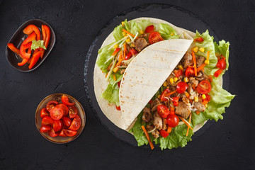Meat and vegetables wraps.
