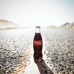 coca-cola bottle on road