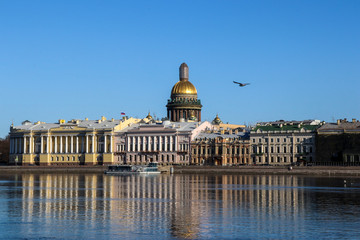 View of the Neva River, еmbankment and St. Isaac's Cathedral. Saint Petersburg, Russia. Seagull flying over the city.