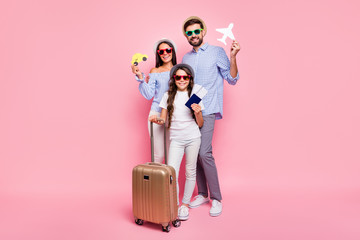 Full size photo of pretty people friends brunettes holding luggage wearing plaid shirt t-shirt eyewear eyeglasses isolated over pink background