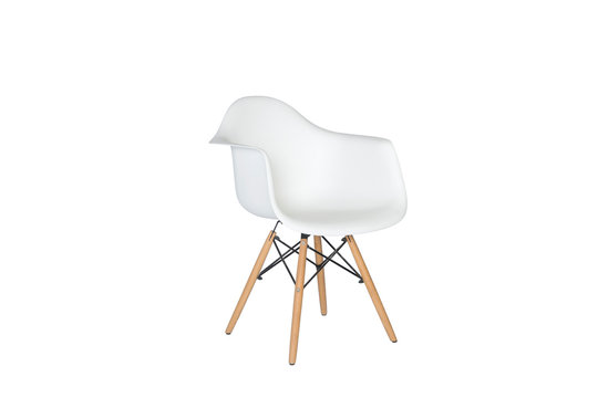 Modern white plastic chair with wooden legs isolated on a white background. Side view