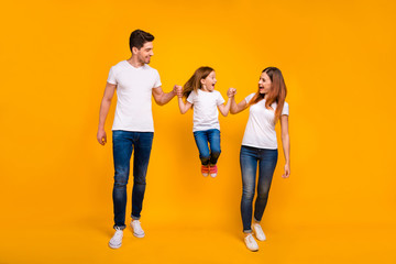 Full length body size view of three nice attractive charming lovely stylish cheerful cheery overjoyed playful person having fun isolated over bright vivid shine yellow background Wall mural