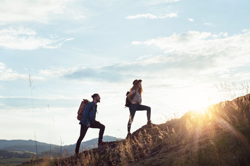 Fototapeta Young tourist couple travellers with backpacks hiking in nature. obraz