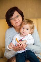 grandmother holding her little granddaughter