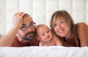 family in a white bedroom