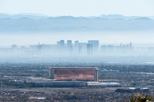 Hazy morning view of the Red Rock Casino Resort and Spa in Summerlin with Las Vegas Strip resorts in background November, 28, 2014 in Las Vegas, Nevada, USA.