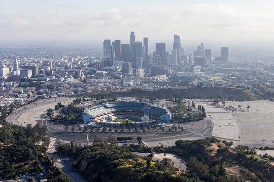 Aerial view of the historic Dodger Stadium with hazy downtown towers in background April 12, 2017 in Los Angeles, California, USA.