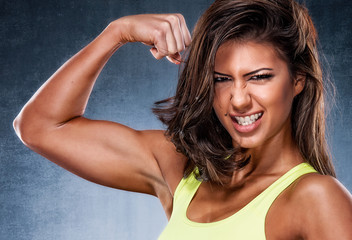Beautiful Fit Woman Flexing Muscles