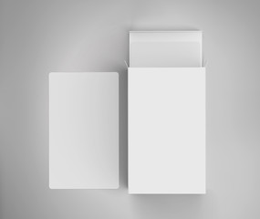 Tarot or playing card box with blank white cards, over light gray background