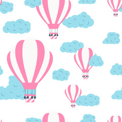 Seamless pattern with hot air balloons in the sky with clouds. Cute vector baby background. Vector wallpaper tourism concept.