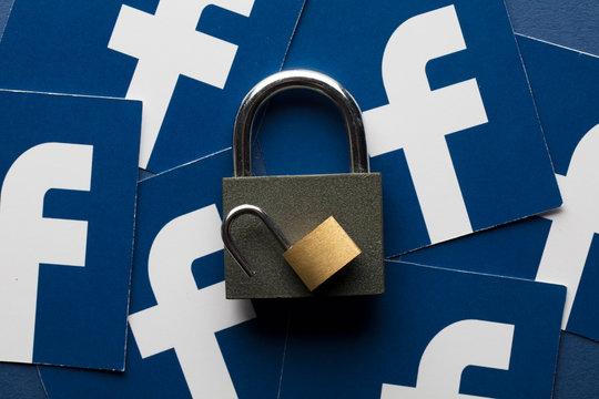 LONDON, UK - OCTOBER 25th 2018: Facebook data security concept. A set of padlocks with the facebook social media logo