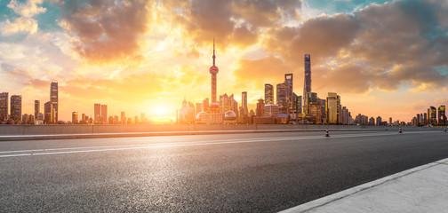 Aluminium Prints Shanghai Shanghai skyline and modern buildings with empty asphalt highway at sunrise,panoramic view.