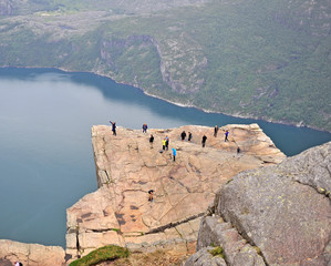 Undefined tourists on Pulpit Rock on summer