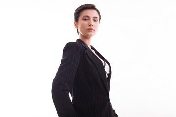 Confident young woman wearing a stylish jacket posing over white background
