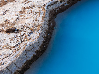 Blue geothermal pond at The Great Geysir, an active volcanic geyser in Southwestern Iceland