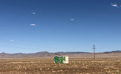 "A shipping container with ""Area 51"" painted on its side sits in the desert in Rachel, Nevada"