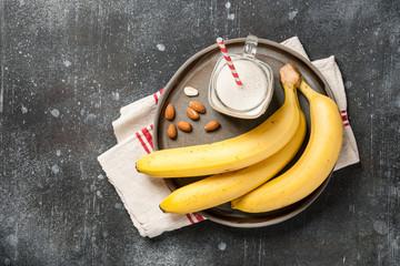 Banana smoothie  and bananas on a plate