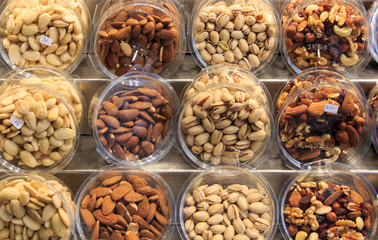 Different types of nuts in wooden displays in the Boqueria market.Concept food