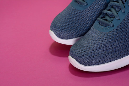 Sport sneakers on pink background with copy space for text. Sport objects background. Sports concept