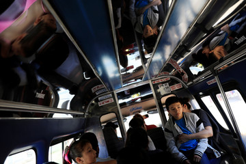 The Wider Image: U.S. government funds free rides from Mexico for migrants