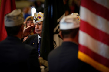 A Veteran salutes the flag before U.S. President Donald Trump speech the AMVETS (American Veterans) National Convention in Louisville
