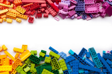 Colorful toy bricks frame with white empty space for your content