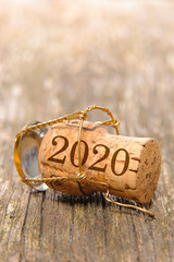 Happy new year 2020 with cork of champagne