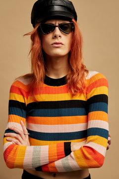 Fashion portrait androgynous woman over orange