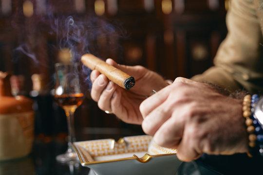 Lighting cigar.