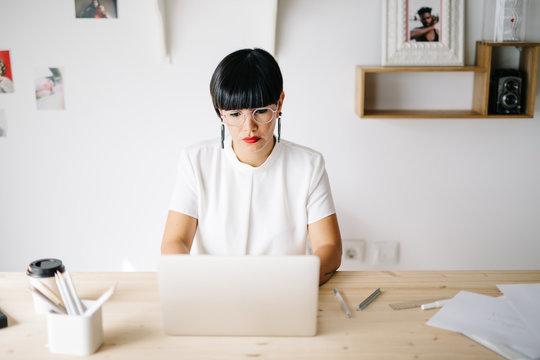 Adult businesswoman working in studio