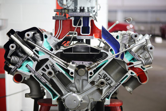 Engine split in half to display internal parts and mechanisms.