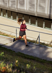Athlete running in urban outdoors to maintain a healthy lifestyle