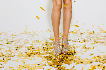 Detail of the legs of a woman standing in a New Year party celebration.