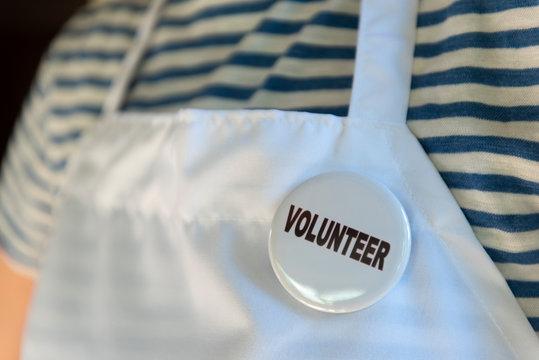Volunteer pin on apron