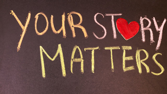 your story matters phrase handwritten on blackboard with heart symbol instead of O