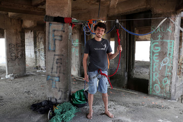 Vitor Mazara, 29, poses for a picture before he walks on a highline between unfinished buildings in Sao Bernardo do Campo