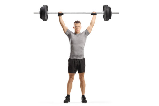 Young muscular guy lifting weights