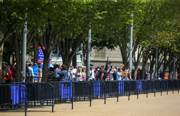 People take photos near construction on perimeter fence by National Park Service and United States Secret Service at the White House in Washington D.C.