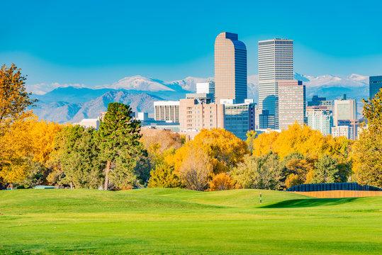 Scenic of Denver Colorado skyline. City Park, Ferril Lake and Rocky Mountains. Located in Denver, Colorado, USA.