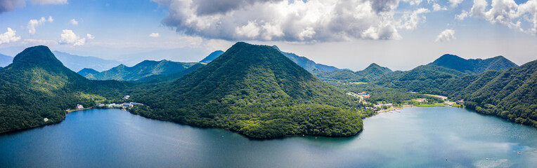 Aerial drone photo - Mt. Haruna rises above Lake Haruna.  Gunma Prefecture, Japan.