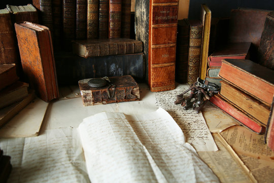 antique workspace with old books and handwriting