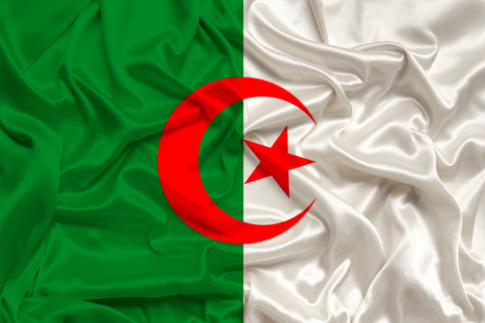 National flag of the country algeria on gentle silk with wind folds, travel concept, immigration, politics
