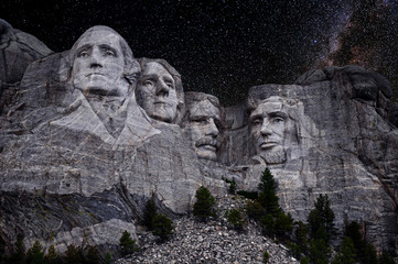 Mt. Rushmore National Memorial Park in South Dakota with stars and milky way background. Sculptures of former U.S. presidents; George Washington, Thomas Jefferson, Theodore Roosevelt,  Abraham Lincoln