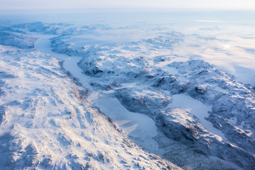 Greenlandic ice cap with frozen mountains and fjord aerial view, near Nuuk, Greenland