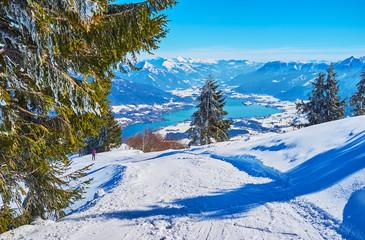 Active winter time spending on Zwolferhorn, St Gilgen, Salzkammergut, Austria