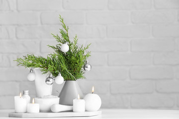 Christmas decor and products for spa treatment on table