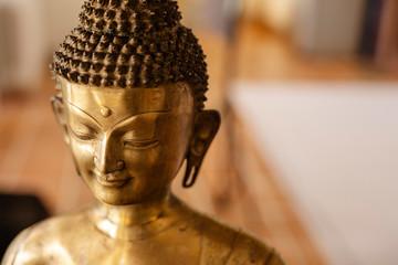 Bronze Buddha statue portrait.